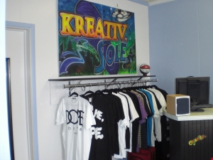 DOPE COUTURE under the KS logo wall...until those 2 shirts sold!!!!