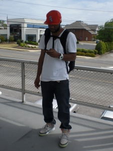 DRE was adhering to the NO SMOKING policy and chose to burn a cig outside the shop...YEEZY's, backpack and all!!!!!